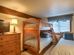 The 3rd bedroom offers a twin-over-twin bunk bed with twin bed