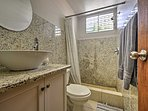 You'll love the marble walls in this pristine bathroom.