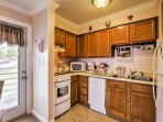 As you step inside your new home-away-from-home, the fully equipped kitchen immediately greets you.