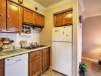 Cook up a mouthwatering dinner as you relish the kitchen's modern appliances and natural wood cabinetry.