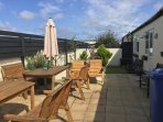 Rear secure garden with BBQ and seating for 15