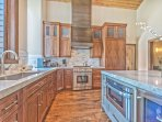 Fully Equipped Gourmet Kitchen with High-end Finishes, Quartz Countertops, Thermador Refrigerator and 4-Burner Gas...