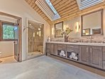 Grand Master Bathroom with Dual Sinks, Soaking Tub, and Large Stone Shower