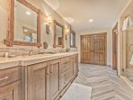 Lower Level Private Master Bath with Dual Sinks and a Tile Shower