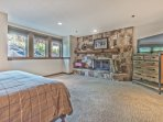 Lower Level Master Bedroom with King Bed, Smart TV, Wood Fireplace and Private Bath with a Tile Shower