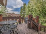 Upper Level Deck with BBQ Grill and Patio Seating - Stairs to Lower Level Deck with Private Hot Tub