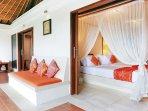 Bali Akasa Villa 4 main bedrooms open on to long cool verandah.