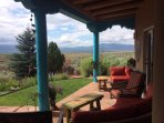 Lounge on our porch and take in the 360° views!