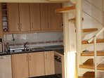 Fully fitted kitchen with dishwasher , fridge/freezer , electric oven and induction hob .