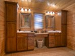 Large Master Bath with jetted tub, glass enclosed shower, and double vanities.