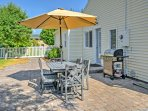 Fire up the grill and enjoy an al fresco meal in the yard.