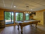 Terrace level game room with Billiards, shuffleboard, darts, corn-hole, wet bar, and 2 TVs