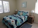 Guest Bdrm 2 with pool view. Full bed, two windows, ceiling fan, lg closet and dresser