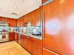 Fully stocked kitchen with stainless steel appliances
