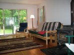 Family room with wood stove; access to rear deck