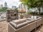 Stay Alfred on Ponce De Leon Avenue Community Patio Fireplace. Relax with friends and maybe even a bottle of wine!