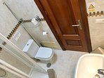 Stunning Main family marble bathroom with walk in shower