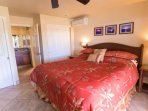 King Bedroom with En Suite Full Bathroom,  Ceiling Fan, In Room A/C Unit, Flat Screen TV, Private Lanai