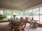 Have breakfast in the screened-in porch overlooking the patios and pool.