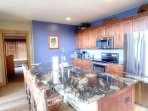 Kitchen - The newly renovated kitchen features brand new granite counter tops and stainless steel appliances.