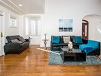 The spacious living room has wooden floors and 2 pull out couch, cable TV and a coffee table