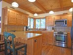 Bright kitchen with stainless steel amenities and a breakfast bar