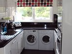 A well appointed kitchen. Integrated dishwasher,washing machine and tumble dryer.