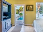 This 1st floor queen bedroom has a door straight out to the pool!