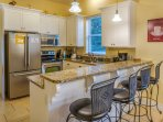 Updated stainless steel appliances and breakfast bar make this kitchen the perfect home away from home