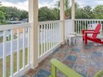 Beautiful tile balcony with adorable Adirondack chairs