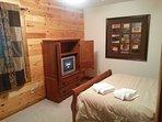 Bedroom 4 Queen with Tv lower level
