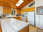 Spacious and bright kitchen with breakfast counter