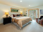 Master bedroom with a king bed and private deck entrance