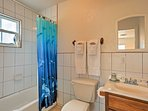 This full en-suite bathroom comes equipped with a tub-shower combo.