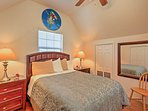 Rest easy in this lofted bedroom.