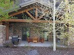 the Huge Covered Patio, over 1000 sq.ft., bar b que, seating, table, out of the elements, if
