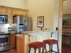 stainless appliances, oven, microwave, disposal, dishwasher, coffee maker, kettle, ice maker fridge