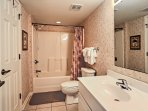 The first bathroom includes a shower/tub combo.