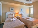 The kids will sleep in comfort on the 2 twin-sized beds in the third bedroom, which provides a flat-screen cable TV.