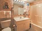 The en-suite third bathroom has a shower/tub combo.
