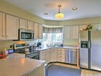 Cooking is a joy in this fully equipped kitchen, featuring stainless steel appliances and ample counter space!