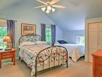 This bedroom offers sleeping arrangements in the full and twin beds.