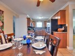 The dining room flows seamlessly into the kitchen.
