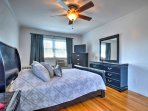 The master bedroom offers a plush queen-sized bed and a flat-screen TV.