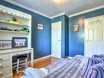 Complete any last-minute work or create crafts at the desk in the third bedroom.