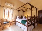 Second bedroom on the first floor with antique Portuguese/Goan beds w/ mosquito net masts