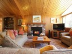 Wood paneling throughout home gives a warm cabin feel.