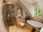 Beautiful family bathroom with large oval sunken in bath with programmable coloured LED mood lights
