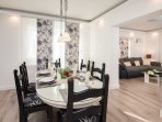 Dining area and fully equipped kitchen (with A/C) with exit to terrace