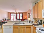 Two can enjoy breakfast at the counter, while for dinner, gather around the 6-person dining room table.